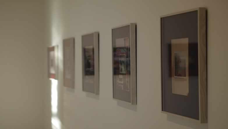 Art Gallery Displaying Art On White Wall